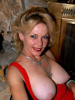 unconforming mature tits stripping