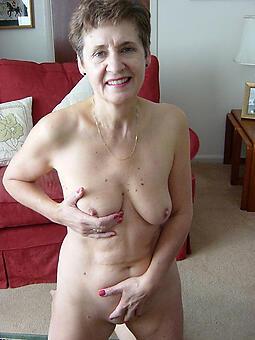 morose nude grandma stripping